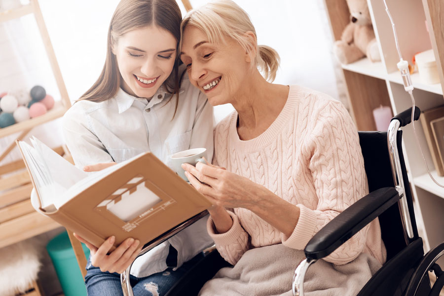 Long Term Care Insurance - Grandmother and Child Looking at Photo Albums
